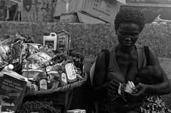 The Hardware seller (fredo f) Tags: afrique africa nigeria lagos marché market nb bw portrait baby bébé droguerie droguiste hardwareseller shop money argent billet note bill ikeja