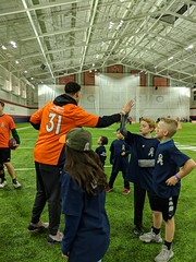 2018_T4T_Denver Broncos Play 60 Clinic 22 (TAPSOrg) Tags: taps tragedyassistanceprogramforsurvivors teams4taps denverbroncos englewood colorado nfl salutetoservice football play60 2018 military indoor vertical kids children player candid highfive