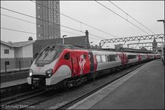 A splash of Virgin Trains 221101 (Mike McNiven) Tags: splash colour pop colourpop coloursplash birmingham newstreet preston wolverhampton manchester deansgate westcoast mainline voyagerdmu diesel multipleunit vt virgin trains manchesterdeansgate bidirectional bidi track train rail railways railway chatmoss chat