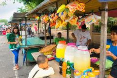 Snacks (Beegee49) Tags: street snacks stalls drinks food people children mother child filipina sony a77 luminar happy planet silay city philippines asia