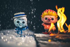 Conflicting Temperatures (3rd-Rate Photography) Tags: snowmiser heatmiser theyearwithoutasantaclaus funkopop georgesirving rankinbass stopmotion christmas miserbrothers poptoys toy figure canon 50mm funko vinyl toyphotography earlware 3rdratephotography 5dmarkiii 365 fire snow ice
