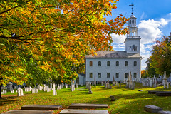 Old First Church from their cemetery, maple leaves (Earl Robicheaux Photography, LLC) Tags: autumn bennington fall northamerica oldfirstchurch unitedstatesofamerica vermont architecture belfry bluesky building categories church churchspire colonialmeetinghouse daylight democracy environment fallcolor government graveyard historic historical history important land landmark lantern old park religiousbuilding scenery seasons spire steeple sun sunlight sunshine tower town village weather white wood worldregionscountries yellowmapleleaves usa