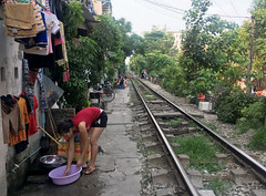 Laundry Day at the Tracks (cowyeow) Tags: hanoi vietnam asia asian street urban city people candid girl young train tracks trainstreet dangerous travel laundry chores woman pretty sexy asiangirl vietnamese vietnamesegirl vietnamesewoman