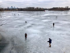 """Ice skating on Lake of the Isles in Minneapolis, Minnesota - one of the best years for """"lake skating"""" because of little to no snow. (thstrand) Tags: hockeysticks cold freezingtemperatures frozenlake viewfromabove people activities activity urbanscene city ice winter unitedstates usa us northamerican northamerica lakes lakeoftheisles mn minneapolis minnesota recreation outdoors iceskaters iceskater iceskating"""