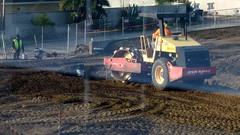 (Rich T. Par) Tags: pomona phillipsranch socal southerncalifornia losangelescounty lacounty constructionsite california tree suburb dirt civilengineering tubes pipes tractor brickwall civilengineers heavyequipment constructionvehicles steamroller roadroller alleyway fence chainlinkfence
