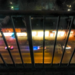 cars behind bars (MyArtistSoul) Tags: night losangeles shermanoaks venturablvd traffic cars buildings glow thevalley marriott hotel balcony bars iphone whimsical symmetry abstract urban square 3518 iph7