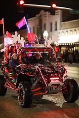 SxS in Christmas Parade (wyojones) Tags: wyoming cody christmasparade sheridanavenue snow cold sidebyside sxs offroadvehicle utv rov lights christmasseason parade man driver tailights bokeh wyojones