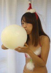She's Blowing Up a White (emotiroi auranaut) Tags: woman lady beauty beautiful model christmas xmas lovely charming attractive blow blowing toy balloon grow growing bigger breathe breathing female feminine femininity gorgeous costume