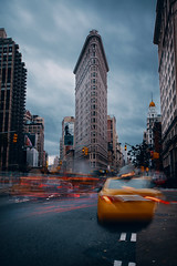 Flatiron (David.Bridges) Tags: road car building city sky intersections sidewalk intersection people new york landmark land mark flat iron flatiron long exposure moody hdr 5d canon wide angle cliche newyork nyc manhattan central ny taxi icon iconic roads highway travel world down town downtown explore clouds skys inta insta