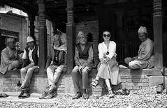 Spot the odd one out   (FIlm) (Harald Philipp) Tags: urban citycenter sidewalk pavement city street cobblestone men woman happy vacation tourism tourist exotic destination travel adventure wanderlust haraldphilipp kodak portra 35mm film grain analog blackandwhite monochrome bw schwartzweiss filmphotography nikon f6 nikkor kathmandu nepal stones shoes