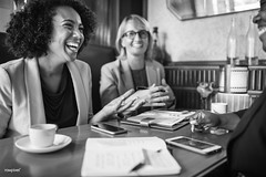 Cheerful businesswomen relaxing at a cafe (rawpixel.com) Tags: africanamerican africandescent afro black blackandwhite blond breaktime business businesswoman cafe cheerful communication corporatebusiness digitaldevice discussion diverse female grayscale happiness happy joyful meeting mobilephone name notebook notepad smartphone smiling talking team teamwork technology together women