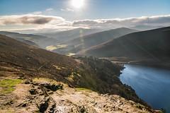 Sally gap - Ireland (noel_milner) Tags: irish ireland lensflare wicklow mountains sky sun forest rocks lake blue clouds dublin sallygap scenery landscape