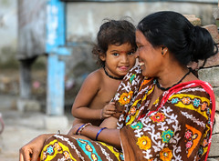 Mother & Child (ybiberman) Tags: varanasi india utterpradesh rajghat mother child daughter people streetphotography naked smile stickingtongue embarrass necklace earring nosering
