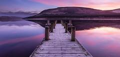 Frosty Jetty (susans7777) Tags: loch frozen frost sunrise dawn water hills still pink purple jetty posts wood landscape walkway cold winter