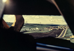 Constructing Glenroy (oz_lightning) Tags: 35mmslrcamera 35mmfilmcamera australia canonpixmamg8150 filmscan glenroy hanimexcs50 melbourne vic yashicaj3 yashinon50mmf2lens building construction film flare framed history landscape scan slide townscape urban victoria aus