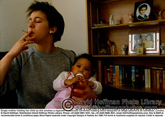"Mum Baby Cigarette (hoffman) Tags: baby black book bottle cigarette estate feeding female holding horizontal housing indoors jewellery lady mother nicotine sitting smoking tobacco woman young youth 181112patchingsetforimagerights london brent uk davidhoffman davidhoffmanphotolibrary socialissues reportage stockphotos""stock photostock photography"" stockphotographs""documentarywwwhoffmanphotoscom copyright"
