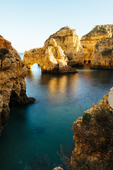 Lagoon with rorck formations near Lagos, Portugal (marcoverch) Tags: grass lanscape goldenhour formation oceanfroant pillar shore vacation cave travel rocks eu sagres portugal green lagoon tourism cliff lagos distriktfaro pt