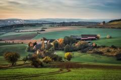 A large old farm (Claudia G. Kukulka) Tags: fog nebel november hills hügel sky himmel house haus farm bauernhof fields felder landscape landschaft painterly schafhof bronnbach südzucker