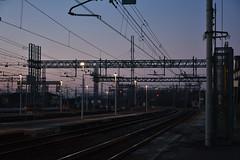 DSC_8062. Railway station at twilight . (angelo appoloni) Tags: twilight railway installations electric trusses sunset colors signal lights tracks crepuscolo impianti ferroviari tralicci elettrici colori del tramonto luci segnaletiche binari