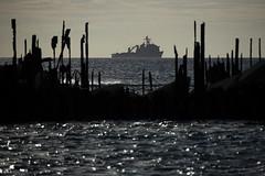 USS Ashland (LSD 48) sits off the coast of Tinian.
