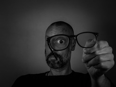 in the land of the blind one eye has found his reading glasses (Gerrit-Jan Visser) Tags: self portrait blackandwhite glasses one eye blind reading found land