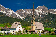 A village in Austria (echumachenco) Tags: mariaalm village church rectory grass green field meadow tree forest mountain mountainside peak rock snow sky cloud alps outdoor landscape april spring steinernesmeer berchtesgadeneralpen pinzgau salzburgerland salzburg austria österreich nikond3100