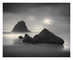 Relics (Vesa Pihanurmi) Tags: seascape beach rock portugal sintra praiadaadraga shoreline ocean clouds seastack stack