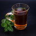 Peppermint tea made of fresh mint on dark background