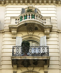 A couple of balconies, Barcelona (Spencer Means) Tags: architecture building house facade balcón balcony balkon window shutters iron ironwork stone stonework baluster balustrade railing dreta eixample barcelona catalunya catalonia dwwg