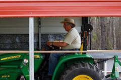 Buitrago drives his tractor at the farm.