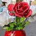 Red and white plastic roses in a vase