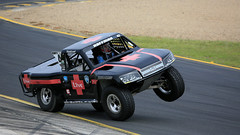Rubber Save (1/2) (Jungle Jack Movements (ferroequinologist)) Tags: jeff hoffman paul morris lift off main straight ramp fly stadium super trucks speed energy sydney motorsport park eastern creek nsw new south wales australia us usa america v8 jump air airtime cole potts ingall motor racing race car hottie track practice pole position times timing hard competition competitive sports racer driver engine build fast grid circuit drive helmet marshal starter sponsor number class texas speedway chev chevrolet brabham robby gordon
