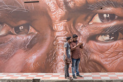 Observation (Geraint Rowland Photography) Tags: art streetart streetportraits fortkochi kerala india fortcochin graffiti bogbrother surveillance mobilephones phone selfie mobiletechnology eyes watching observing people graffitiart artinindia artfestival canonindia ngtuk