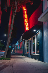 Liquor, all great stories start with some. (rob_luna) Tags: sony a7r3 a7riii 35mm zeiss landscape long exposure culver city california liquor beer alcohol los angeles store building color lights night dogwood52 dogwood2019 dogwoodweek4 full frame structure