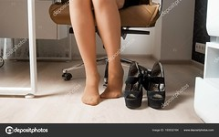 Closeup image of barefoot businesswoman feet in pantyhose under office desk (luissancheztenor) Tags: business female office foot woman businesswoman lady person high sitting adult leg work people heel pain day shoe tired beautiful caucasian girl pretty white young background clerk relax comfort comfortable relaxation varicose black heeled off health feet swollen disorder elegant workplace hurt clothing graze executive hurting worker exhausted bare closeup