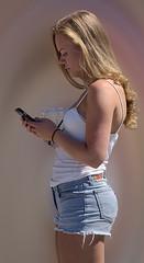 Sending A Message (Scott 97006) Tags: woman female lady blonde pretty beautiful phone shorts cute