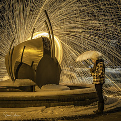 Under My Umbrella (Exhorseman) Tags: yegphotographer yeg stalbert t8n igyeg imagesofcanada butterflysails longexposure weownthenightab weownthenight steelwool streetphotography finesteelwool sparks finesteel nightphotography lightpainting paintingwithlight creative hotshots d750 nikon images lowlight lifeofadventure photonewsmagazine canadaonline lighttrails umbrella fire danger rain snow spinning