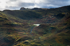 Mountain lake (Rico the noob) Tags: 2018 rock d850 lakedistrict 2470mm nature water mountains outdoor lake 2470mmf28 clouds uk hills published river sky rocks dof stones landscape mountain