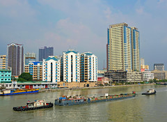 Tugging a River Barge (Colorado Sands) Tags: river water watercraft waterfront city barge tugboat boat highrise sandraleidholdt southeastasia manila asia philippines tow towing riverbarge building sanjuanriver transportation