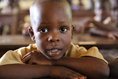 A young boy in class (Global Partnership for Education - GPE) Tags: gpe globalpartnershipforeducation education benin educationinbenin students youngboy boy boylookingintocamera