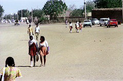 76-264 (ndpa / s. lundeen, archivist) Tags: nick dewolf color photograph by 1976 1970s film 35mm 76 reel76 early1976 africa northernafrica northeastafrica sudan thesudan african sudanese khartoum omdurman streetlife citylife candid streetphotography people street woman youngwoman women youngwomen girl girls hijab bag handbag children kids man men youngman youngmen westernclothing cars vehicles automobiles trees building buildings dress dresses schoolchildren khartoumstate photographbynickdewolf