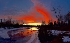Sunset January 12 Panorama (John Andersen (JPAndersen images)) Tags: bridge calgary city clouds elbowriver evening park sculpture towers train
