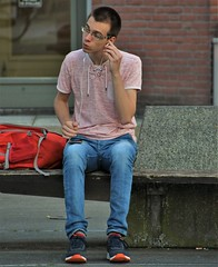 IMG_2375 (Skinny Guy Lover) Tags: outdoor people candid guy man male dude sitting sit seated jeans bluejeans glasses smartphone earpods earbuds earplugs