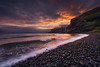 Scottish evening tones (Ron Jansen - EyeSeeLight Photography) Tags: scotland isle skye sunset drama cloud rain waves water rocks shine glow tones line lines sea ocean uk united kingdom pebbles waterfall
