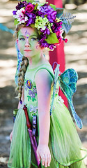 Little Flower Fairy (wyojones) Tags: texas texasrenaissancefestival toddmission texasrenfest renfest renfaire renaissancefaire faire renaissancefestival festival trf beauty girl littlegirl fairy beautiful pretty lovely gorgeous cute brunette blueeyes littlefairy wings flowers headdress knife facepaint