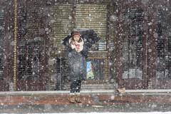 Checking (Tim Brown's Pictures) Tags: washingtondc city urban 14thstreetcorridor ustreet winter snow snowing snowstorm snowflakes january132019 people pedestrians washington dc unitedstates