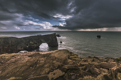 The arch and the rain (Sizun Eye) Tags: iceland dyrhólaey arch cliffs rocks coast horizon rain clouds travel travelling visit promontory sizuneye nikond750 nikon1424mmf28 nisifilters