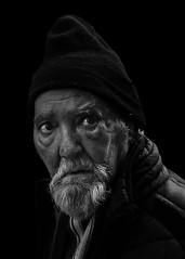 Portrait (D80_526943) (Itzick) Tags: denmark copenhagen candid bw blackbackground bwportrait beard man hat face facialexpression portrait streetphotography d800 itzick