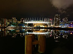 BC Place from False Creek (walneylad) Tags: bcplace rogersarena yaletown chinatown falsecreek downtown cbd vancouver britishcolumbia canada stadium building condominiums highrises towers condos apartments seawall boats water dark night evening lights reflections colour january winter scenery view cityscape skyline cityview urbanscene urbanlife piers dock clouds greysky