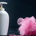 White bottle with shower gel and washcloth thumbnail